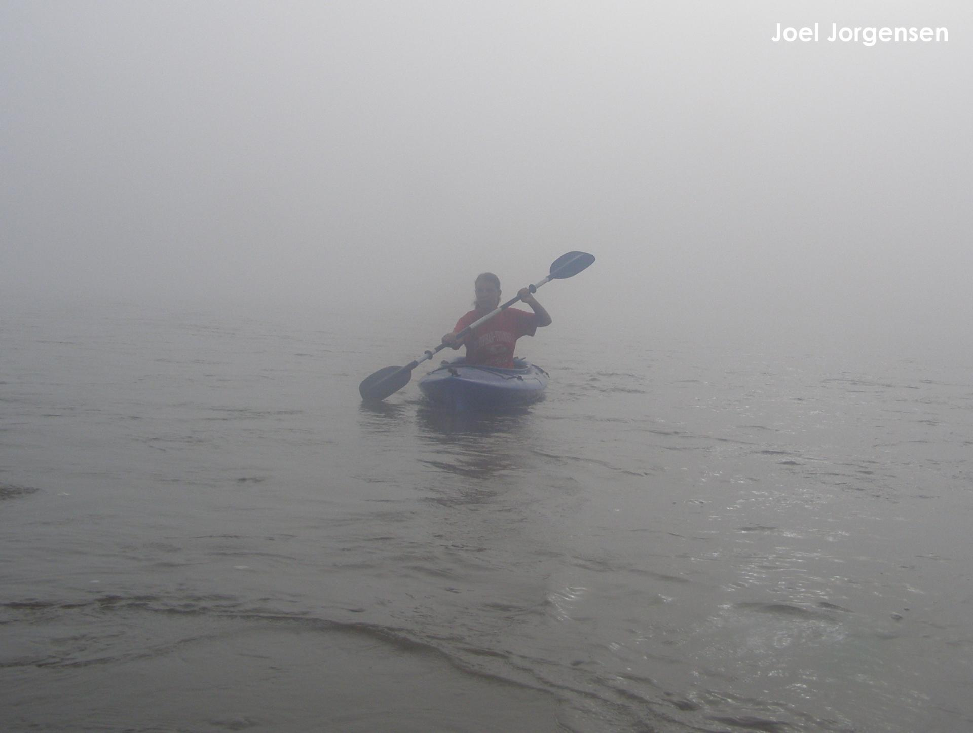Lauren Dinan kayaking down the river in the mist